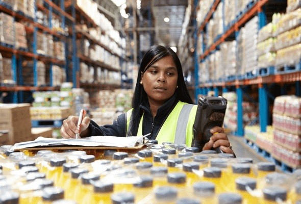 Woman in warehouse with scanner